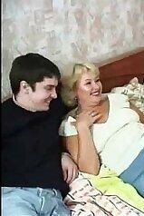 Fun-loving Russian mom takes two huge cocks