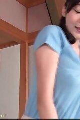 Busty Asian woman gets ready for love-making