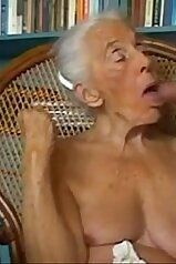 Senile-looking old lady gets to suck on that meaty cock