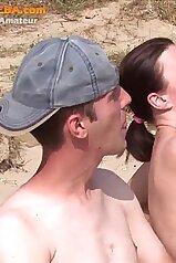 Three-way sex session unfolding at the local beach