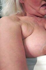 Grey-haired granny enjoying breast worship