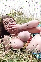 Big-breasted lady getting fucked in the grass