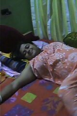 Playful fat Indian lady rolling around on the bed