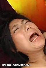 Screaming Japanese babe endures hard sex