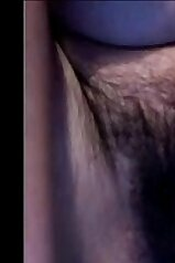 Hairy pussy showcased in a teasing video