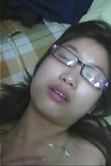 Asian angel in glasses is enjoying hardcore sex